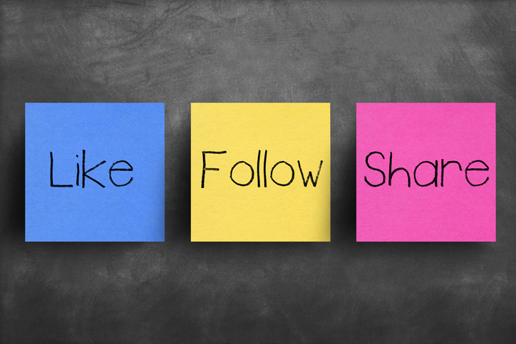 The words like, follow, share on colourful post-its